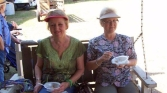 Enjoying delicious blueberry cobbler on our country store's porch swing!